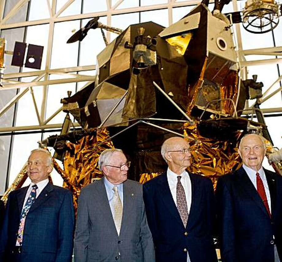 From left,  Buzz Aldrin, Neil Armstrong, Maj. Gen. Michael Collins, Sen. John Glenn, pose for a photograph in front of the  lunar module device at the Smithsonian National Air and Space Museum in Washington on Sunday, July 19, 2009.  (AP Photo/The Washington Post, Marcus Yam)  **  WASHINGTON TIMES OUT,   NEW YORK TIMES OUT,   USA TODAY OUT,   DC EXAMINER OUT,   NO SALES,   NO ARCHIVES,  NO MAGAZINES,  MANDATORY CREDIT ** Photo: Marcus Yam, AP