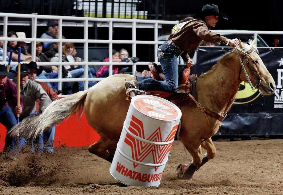 Nikki Steffes and Nilla, of Vale, S.D., knock over a barrel at their inaugural competition at the San Antonio Stock Show & Rodeo on Thursday, Feb. 9, 2012 at the AT&T Center. Steffes time was 19.40. The pair returns tonight and Saturday. Photo: EDWARD A. ORNELAS, SAN ANTONIO EXPRESS-NEWS / © SAN ANTONIO EXPRESS-NEWS (NFS)