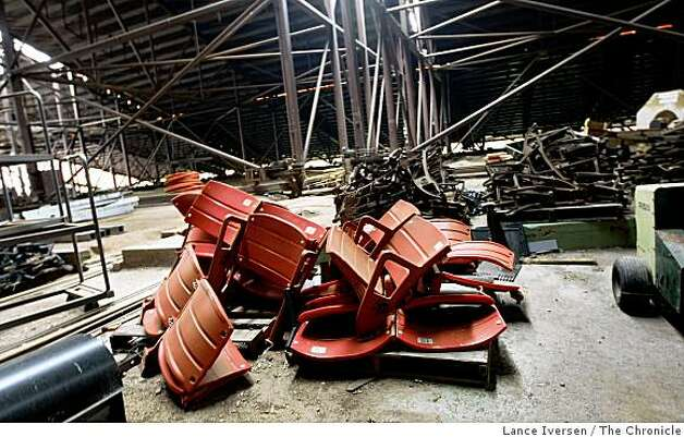 Old Stadium seats are pilled up under the Candlestick Park bleachers as the 49ers home shows its age. Photo: Lance Iversen, The Chronicle