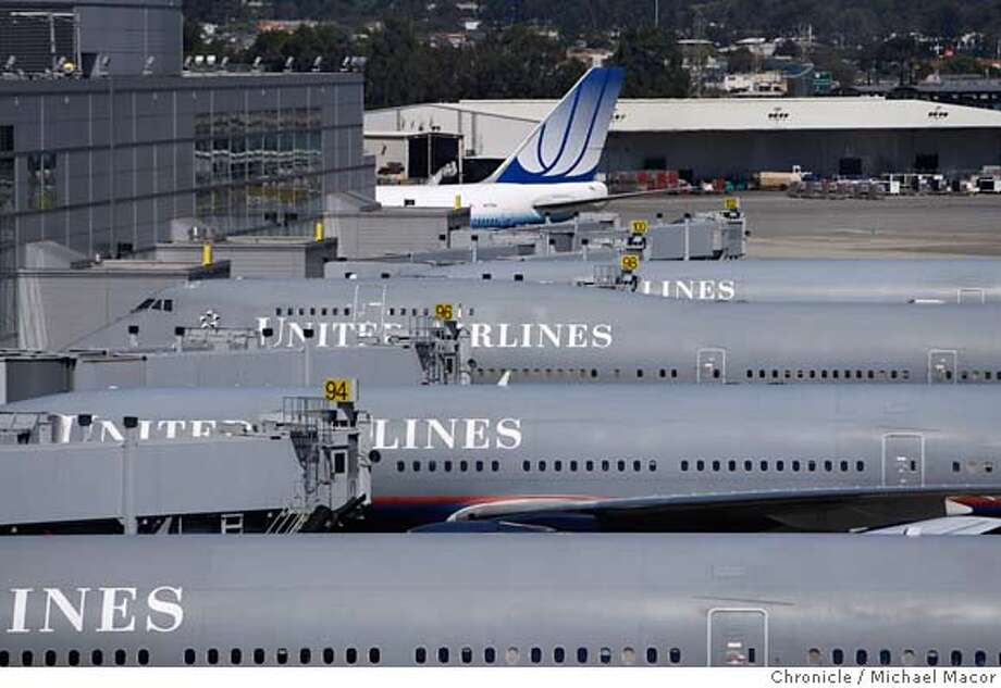 ###Live Caption:United Airlines announced Friday, March 14, 2008 that its boosting its ticket prices by as much as $50 round-trip, raising the stakes in the airline industry's battle against rapidly rising fuel costs. United Airlines planes sit at terminals at San Francisco International Airport in Millbrae, Calif. on July 19, 2007. Photo by Michael Macor / San Francisco Chronicle###Caption History:United Airlines announced Friday, March 14, 2008 that its boosting its ticket prices by as much as $50 round-trip, raising the stakes in the airline industry's battle against rapidly rising fuel costs. United Airlines planes sit at terminals at San Francisco International Airport in Millbrae, Calif. on July 19, 2007.  Photo by Michael Macor / San Francisco Chronicle###Notes:###Special Instructions:MANDATORY CREDIT FOR PHOTOG AND SAN FRANCISCO CHRONICLE/NO SALES-MAGS OUT Photo: Michael Macor