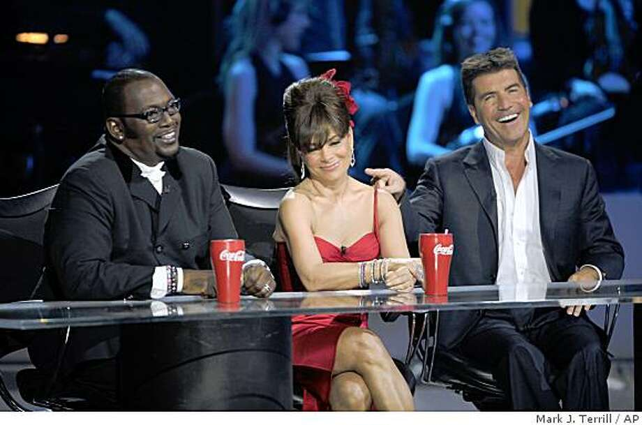 "Randy Jackson, left, Paula Abdul, center, and Simon Cowell are seen on stage at the ""Idol Gives Back"" fundraising special of ""American Idol"" in Los Angeles on Sunday April 6, 2008. Photo: Mark J. Terrill, AP"