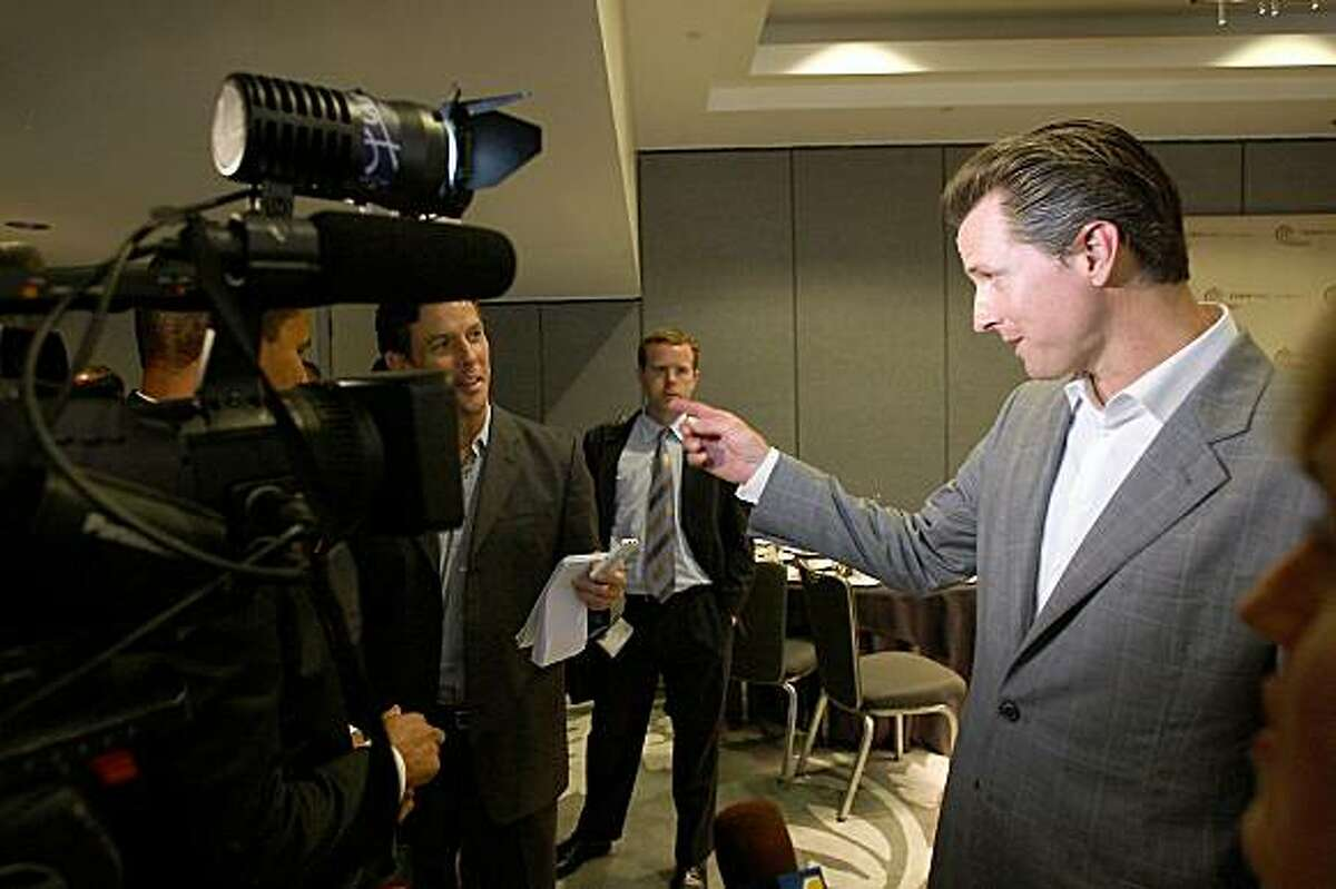 LOS ANGELES, CA - JULY 9: California gubernatorial candidate and San Francisco Mayor Gavin Newsom talks to a reporter as he leaves after speaking at a meeting of Town Hall Los Angeles on July 9, 2009 in Los Angeles, California. The mayor spoke on Healthy San Francisco: A Local Model for Universal Coverage and National Reform. Town Hall Los Angeles is a nonprofit, nonpartisan membership organization begun in 1937 to promote open public discussions of the issues of the day. (Photo by David McNew/Getty Images)