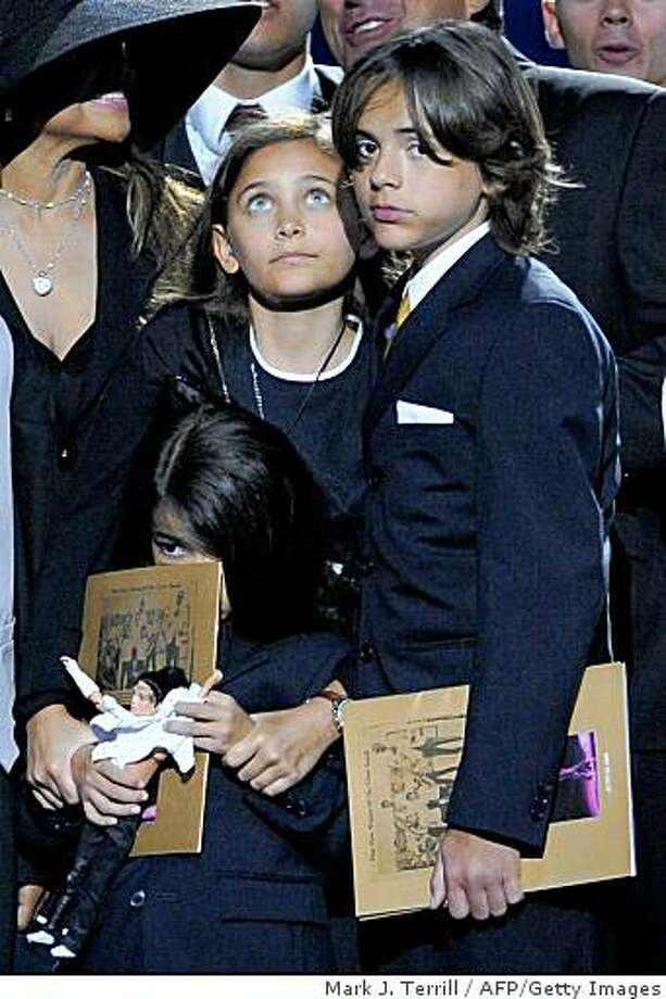 Paris Jackson (L) and her brothers Prince Michael Jackson I (R) and Prince Michael Jackson II on stage during the memorial service for Michael Jackson at the Staples Center in Los Angeles on July 7, 2009.  TOPSHOTS   AFP PHOTO (Photo credit should read MARK J. TERRILL/AFP/Getty Images) Photo: Mark J. Terrill, AFP/Getty Images