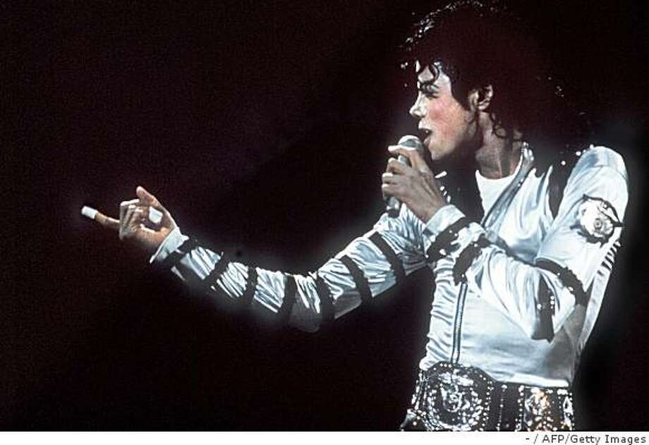 """(FILES) US pop star and entertainer Micheal Jackson performs during a concert at the historical Berlin Reichstag on June 19, 1988. Michael Jackson died on June 25, 2009 after suffering a cardiac arrest, sending shockwaves sweeping across the world and tributes pouring in on June 26 for the tortured music icon revered as the """"King of Pop."""" AFP PHOTO/DPA/- (Photo credit should read -/AFP/Getty Images) Photo: -, AFP/Getty Images"""