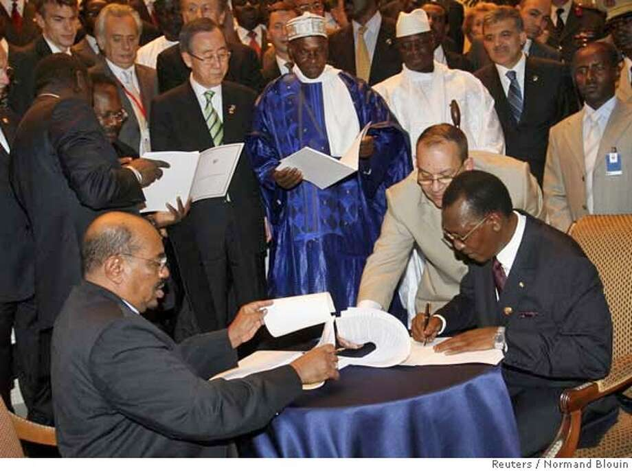 ###Live Caption:Sudanese President Omar Hassan al-Bashir (bottom L) and Chad's president Idriss Deby (R) sign a peace deal while U.N. Secretary-General Ban Ki-moon (top) and Senegal's president Abdoulaye Wade (C) and Gambian President Yahya Jammeh look on in Dakar, March 13, 2008. Sudan's President Omar Hassan al-Bashir and his Chadian counterpart Idriss Deby signed a peace agreement on Thursday meant to end cross-border rebel attacks in a region which includes Sudan's war-torn Darfur.  The signing, witnessed by U.N. Secretary-General Ban Ki-moon and Senegal's President Abdoulaye Wade, followed talks in Dakar meant to revive a string of bilateral pacts that have failed to end fighting on both sides of the Chad-Sudan border. REUTERS/Normand Blouin (SENEGAL)###Caption History:Sudanese President Omar Hassan al-Bashir (bottom L) and Chad's president Idriss Deby (R) sign a peace deal while U.N. Secretary-General Ban Ki-moon (top) and Senegal's president Abdoulaye Wade (C) and Gambian President Yahya Jammeh look on in Dakar, March 13, 2008. Sudan's President Omar Hassan al-Bashir and his Chadian counterpart Idriss Deby signed a peace agreement on Thursday meant to end cross-border rebel attacks in a region which includes Sudan's war-torn Darfur.  The signing, witnessed by U.N. Secretary-General Ban Ki-moon and Senegal's President Abdoulaye Wade, followed talks in Dakar meant to revive a string of bilateral pacts that have failed to end fighting on both sides of the Chad-Sudan border. REUTERS/Normand Blouin (SENEGAL)###Notes:Sudanese President al-Bashir and Chad's president Deby sign a peace deal while U.N. Secretary-General Ban Ki-moon and Senegal's president Wade and Gambian President Jammeh look on in Dakar###Special Instructions:0 Photo: NORMAND BLOUIN