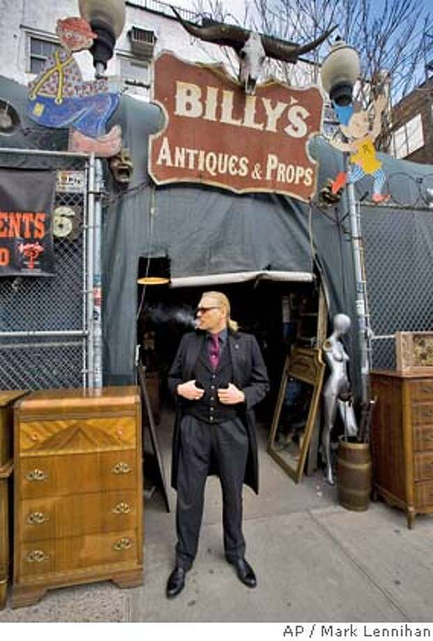 William Leroy, owner of Billy's Antiques & Props, stands at the store's entrance on Wednesday, Feb. 27, 2008 in the Lower East Side neighborhood of New York. Leroy, who has many European customers, prefers payment in euros so he can stockpile the currency for his annual antique buying trip to Paris. (AP Photo/Mark Lennihan) Photo: MARK LENNIHAN