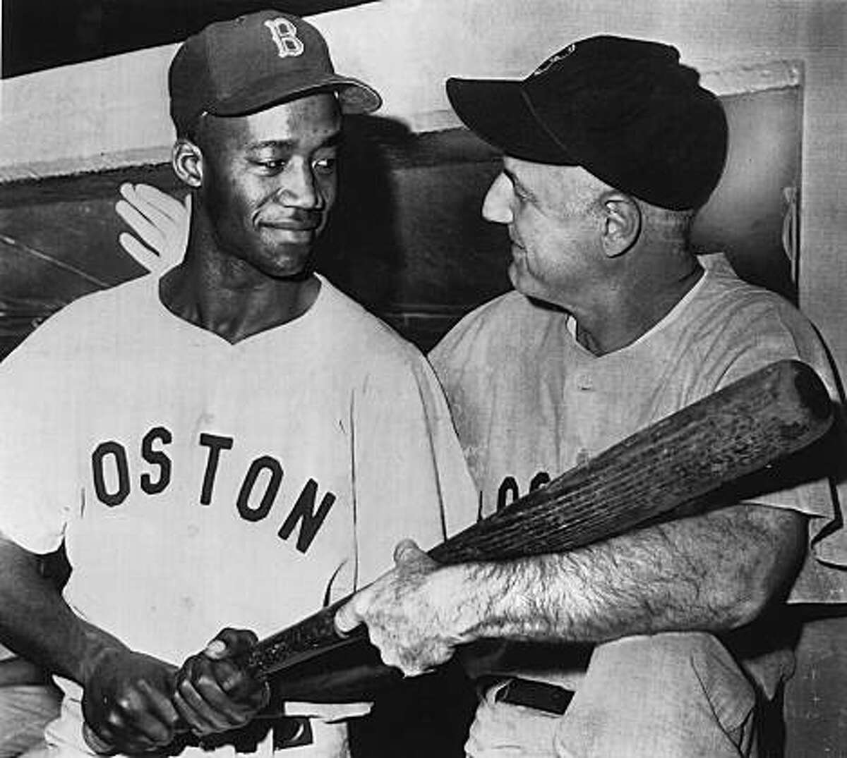 Pumpsie Green, left, with Boston Red Sox, manager Billy Jurges July 22, 1959, in Chicago, before a game against the White Sox. It was Green's first day with the Boston's big-league team.
