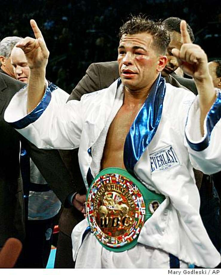 In this Jan. 24, 2004 file photo, Arturo Gatti celebrates after defeating Gianluca Branco of Italy for the WBC junior welterweight championship in Atlantic City, N.J. Officials say Gatti has been found dead in a hotel room at the seaside resort of Porto de Galinhas in northeastern Brazil on Saturday, July 11, 2009, where he arrived on Friday with his wife and one-year-old son. The spokesman said  it was unclear how Gatti died. He was 37. Photo: Mary Godleski, AP