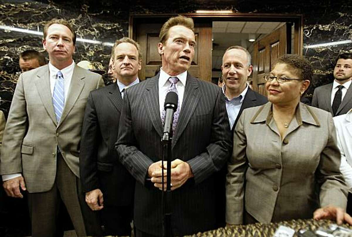 Gov. Arnold Schwarzenegger, flanked by Senate Minority Leader Dennis Hollingsworth, R-Temecula, left, Assembly Minority Leader Sam Blakeslee, second from left, Senate President Pro Tem Darrell Steinberg, D-Sacramento, second from right and Assembly Speaker Karen Bass, D-Los Angeles, discusses the budget compromise reached to resolve California's $26.3 billion budget deficit at the Capitol in Sacramento, Calif., Monday, July 20, 2009.(AP Photo/Rich Pedroncelli)