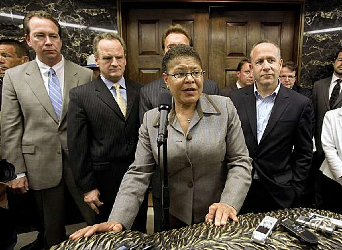 Assembly Speaker Karen Bass, D-Los Angeles, discusses the budget agreement worked out with Gov. Arnold Schwarzenegger, background, and Legislative leaders, including, Senate Minority Leader Dennis Hollingsworth, R-Temecula, left, Assembly Minority Leader Sam Blakeslee, second from left, and Senate President Pro Tem Darrell Steinberg, D-Sacramento, second from right at the Capitol in Sacramento, Calif., Monday, July 20, 2009.(AP Photo/Rich Pedroncelli)