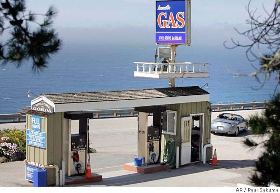 A customer leaves after filling up at this gas station in Gorda, Calif., Tuesday, March 11, 2008. Regular gas was sold at $5.19 per gallon at his station. In background is the Pacific Ocean at this remote coastal town. (AP Photo/Paul Sakuma) Photo: Paul Sakuma