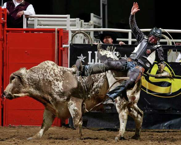 Allen Helmuth, of Eugene, Ore.,  is thrown off his bull during the bull riding event at the San Antonio Stock Show & Rodeo on Thursday, Feb. 9, 2012 at the AT&T Center. Photo: EDWARD A. ORNELAS, SAN ANTONIO EXPRESS-NEWS / © SAN ANTONIO EXPRESS-NEWS (NFS)