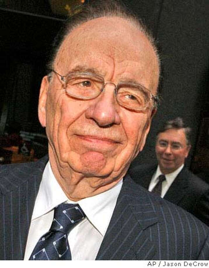 ** FILE ** In a file photo News Corp. chairman and chief executive Rupert Murdoch emerges from a meeting with key members of the Bancroft family, who control Dow Jones & Co., Monday, June 4, 2007 in New York. Murdoch's News Corp. has reached a tentative agreement to buy Dow Jones & Co., publisher of The Wall Street Journal, the Journal reported on its Web site Monday July 16, 2007. (AP Photo/Jason DeCrow)  Ran on: 07-19-2007  Rupert Murdoch has long wanted to own the Journal. Photo: Jason DeCrow