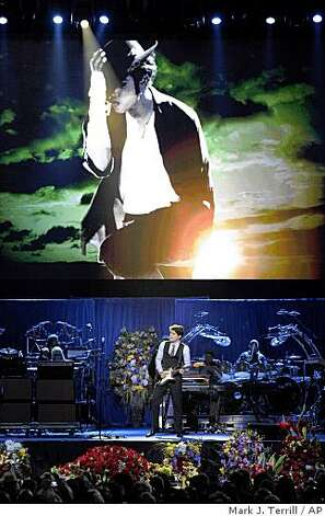 Musician John Mayer performs during the memorial service for Michael Jackson at the Staples Center. Photo: Mark J. Terrill, AP