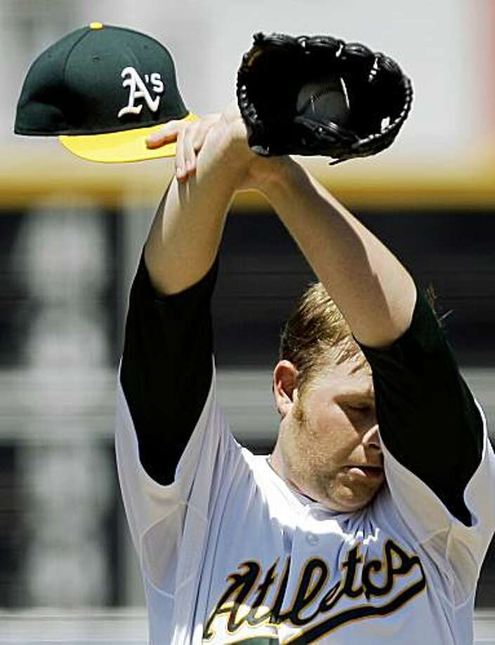 Oakland Athletics' Brett Anderson reacts after giving up a base hit to Los Angeles Angels' Bobby Abreu in the seventh inning of a baseball game Sunday, July 19, 2009, in Oakland, Calif., breaking up a perfect game. Abreu later hit a home run to win the game 1-0 in the 10th inning. (AP Photo/Ben Margot) Photo: Ben Margot, AP