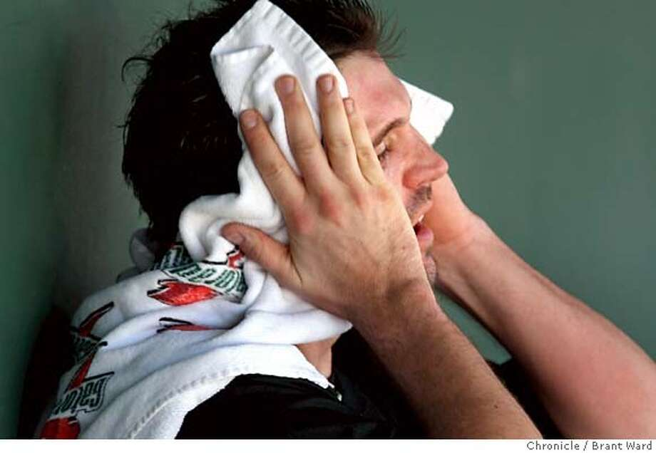 Giants pitcher Barry Zito wiped his face with a towel after being taken out of the game in the first inning. On March 1, 2008, the San Francisco Giants played the Oakland Athletics in a pre-season exhibition game at Scottsdale Stadium. Photo by Brant Ward / San Francisco Chronicle Photo: Brant Ward