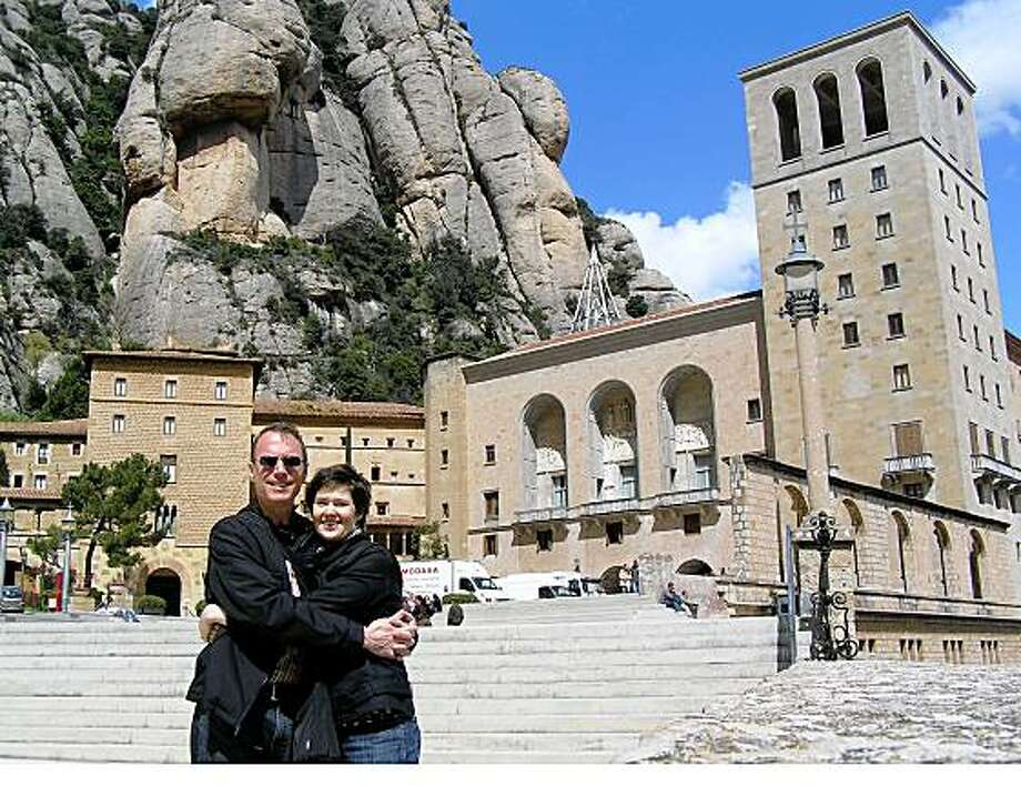 USE JULY 19 Stefan Gruenwedel and Susan Parini in front of Benedictine monastery in Montserrat, Spain. JUSTBACK