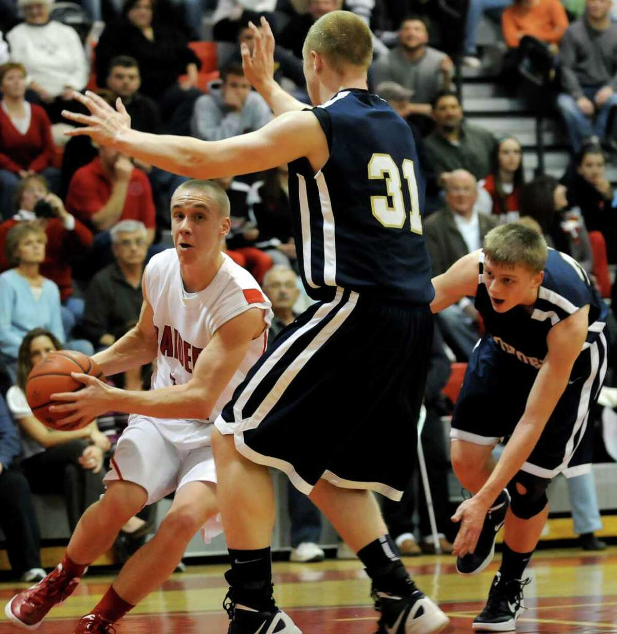 Mechanicville's Ryan McBride (15), left, controls the ball as Cohoes' Kevin Napier (31), center, and Nate Monson (32) defend during their basketball game on Thursday, Feb. 9, 2012, at Mechanicville High in Mechanicville, N.Y. Mechanicville wins 72-54. (Cindy Schultz / Times Union)