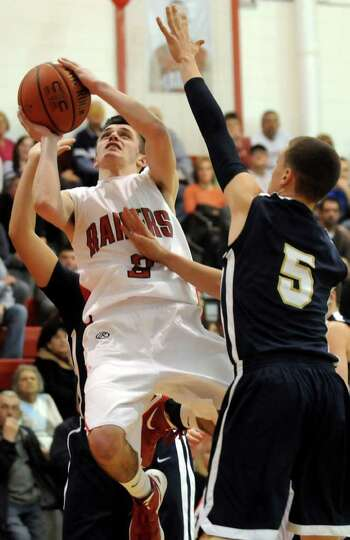 Mechanicville's Adam Dunn (3), left, shoots for the hoop as Cohoes' Sam DeCelle (5) defends during t