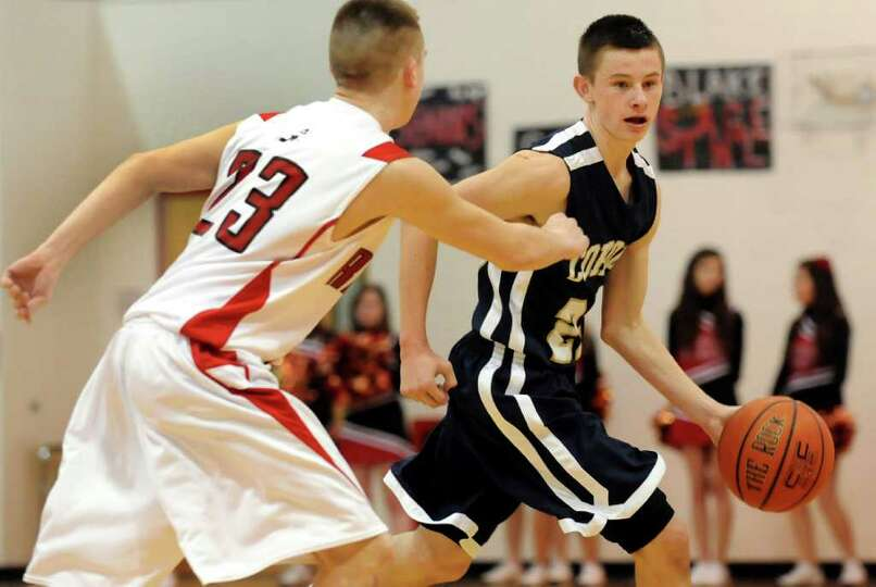Cohoes' Brandon LaForest (23), right, controls the ball as Mechanicville's Mike Cannizzo (23) defend