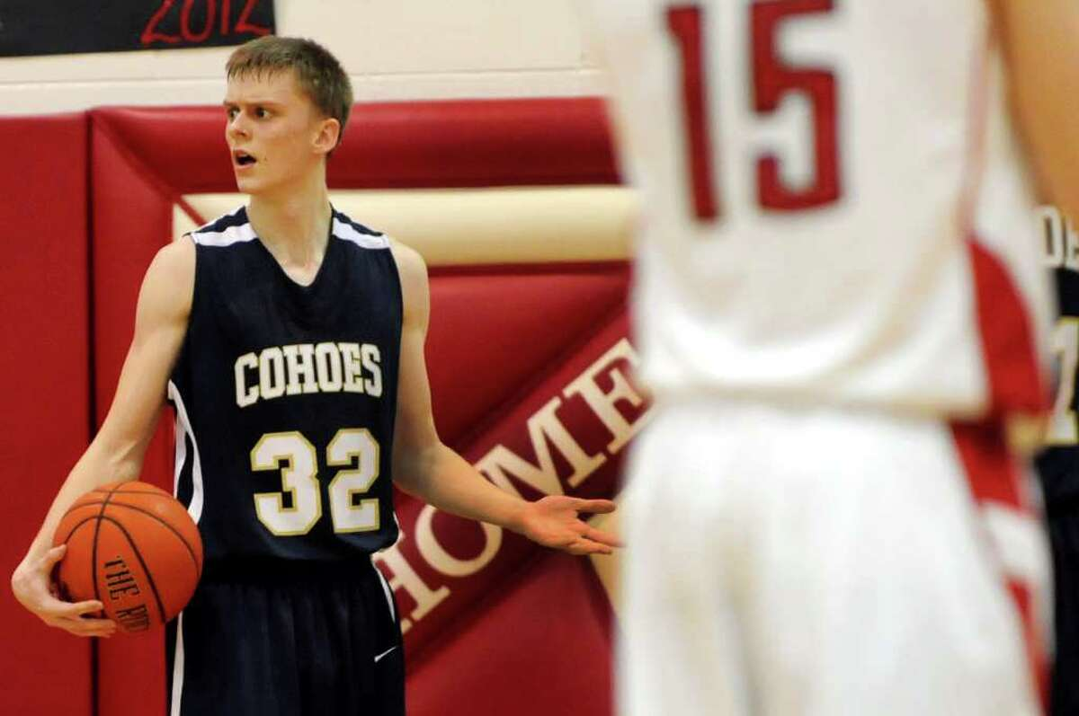 Cohoes' Nate Monson (32), left, reacts to an officials call as the clock winds down during their basketball game against Mechanicville on Thursday, Feb. 9, 2012, at Mechanicville High in Mechanicville, N.Y. (Cindy Schultz / Times Union)