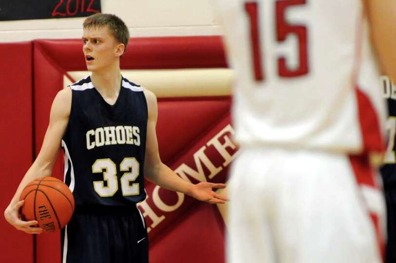 Cohoes' Nate Monson (32), left, reacts to an officials call as the clock winds down during their bas