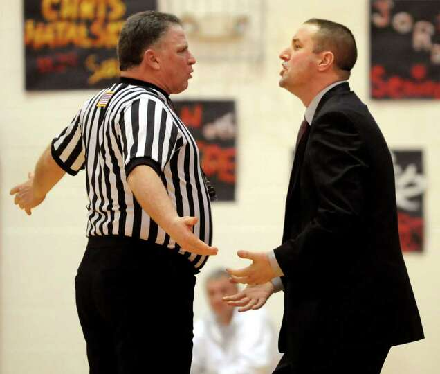 Mechanicville's head coach Rian Ricardson, right, disagrees with an official's call during their bas