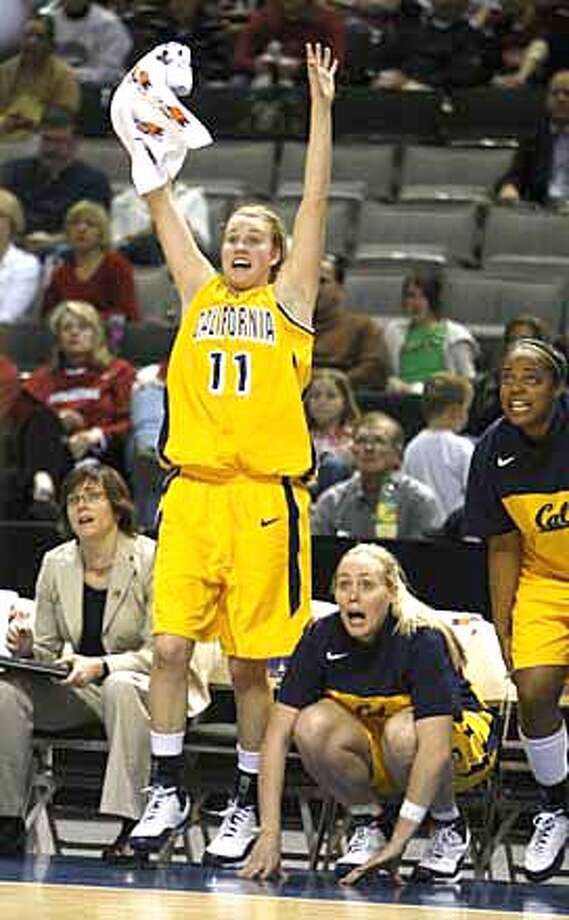 ###Live Caption:Cal Bears Kelsey Adrian (11) cheers from the bench in the final minutes of the game.  Cal faces Arizona State University (ASU) in the Pac 10 women's basketball tournament semifinals at HP Pavilion in San Jose, Calif., on March 9, 2008. Cal won 65-61. Photo by Michael Maloney / San Francisco Chronicle###Caption History:Cal Bears Kelsey Adrian (11) cheers from the bench in the final minutes of the game.  Cal faces Arizona State University (ASU) in the Pac 10 women's basketball tournament semifinals at HP Pavilion in San Jose, Calif. on March 9, 2008. Cal won 65-61. Photo by Michael Maloney / San Francisco Chronicle###Notes:***roster###Special Instructions:MANDATORY CREDIT FOR PHOTOG AND SAN FRANCISCO CHRONICLE/NO SALES-MAGS OUT Photo: Michael Maloney