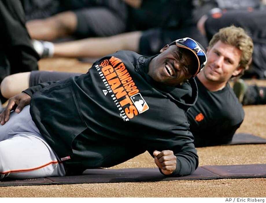 San Francisco Giants second baseman Ray Durham, left, laughs while stretching as Kevin Frandsen, right, looks on during their spring training baseball workout in Scottsdale, Ariz., Tuesday, Feb. 19, 2008. Both Durham and Frandsen are competiing for the starting second baseman position. (AP Photo/Eric Risberg) EFE OUT Photo: Eric Risberg
