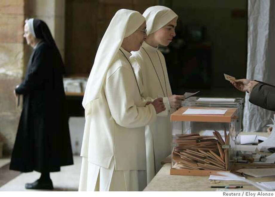 Catholic nuns cast their votes at an Oviedo polling station during Spain's general elections March 9, 2008. REUTERS/Eloy Alonso (SPAIN)  Ran on: 03-10-2008  Catholic nuns vote in Oviedo, the capital of Asturias, a coastal province in northwest Spain. Nationally, voter turnout was high. Photo: ELOY ALONSO