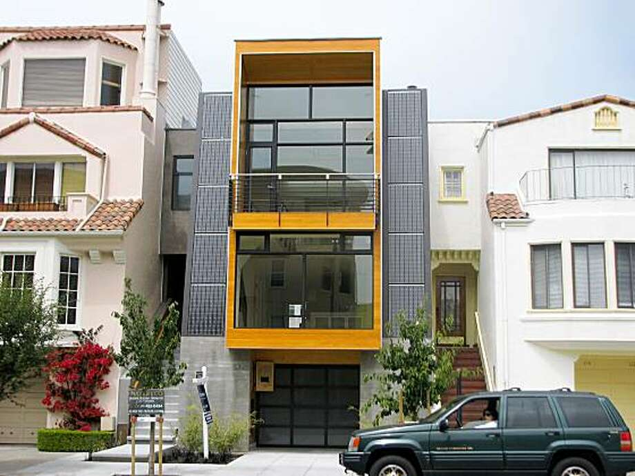 118 Cervantes in the Marina is a 2009 house that updates the look of the neighborhood -- and also addresses larger environmental concerns by attaching photovoltaic solar panels to its walls. Photo: John King, The Chronicle