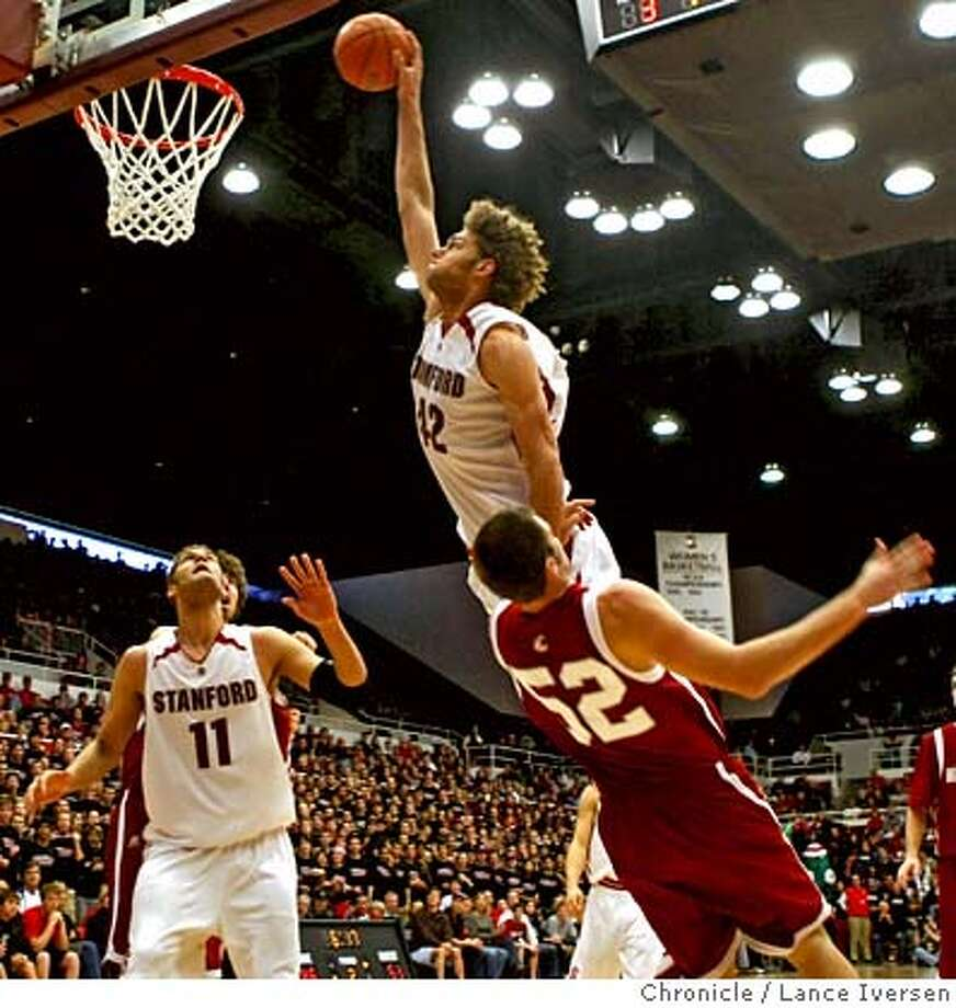 Stanford Center Robin Lopez (42) goes up to shoot against the defense of Washington State forward Caleb Forrest (52) during second half action at their college basketball game, Saturday, March 1, 2008, in Palo Alto. Photo By Lance Iversen / San Francisco Chronicle. Photo: Lance Iversen