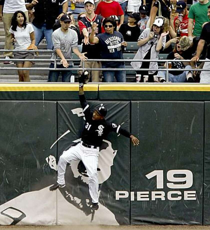 Chicago White Sox center fielder DeWayne Wise starts to come down with the ball on a leaping catch of a ball hit by Tampa Bay Rays' Gabe Kapler during the ninth inning of a baseball game Thursday, July 23, 2009, in Chicago. Chicago's Mark Buehrle threw a perfect game, the 18th in major league history, as Chicago won 5-0. (AP Photo/Chicago Tribune, Phil Velasquez) ** CHICAGO OUT  ROCKFORD OUT  TV OUT  MAGS OUT  NO SALES ** Photo: Phil Velasquez, AP