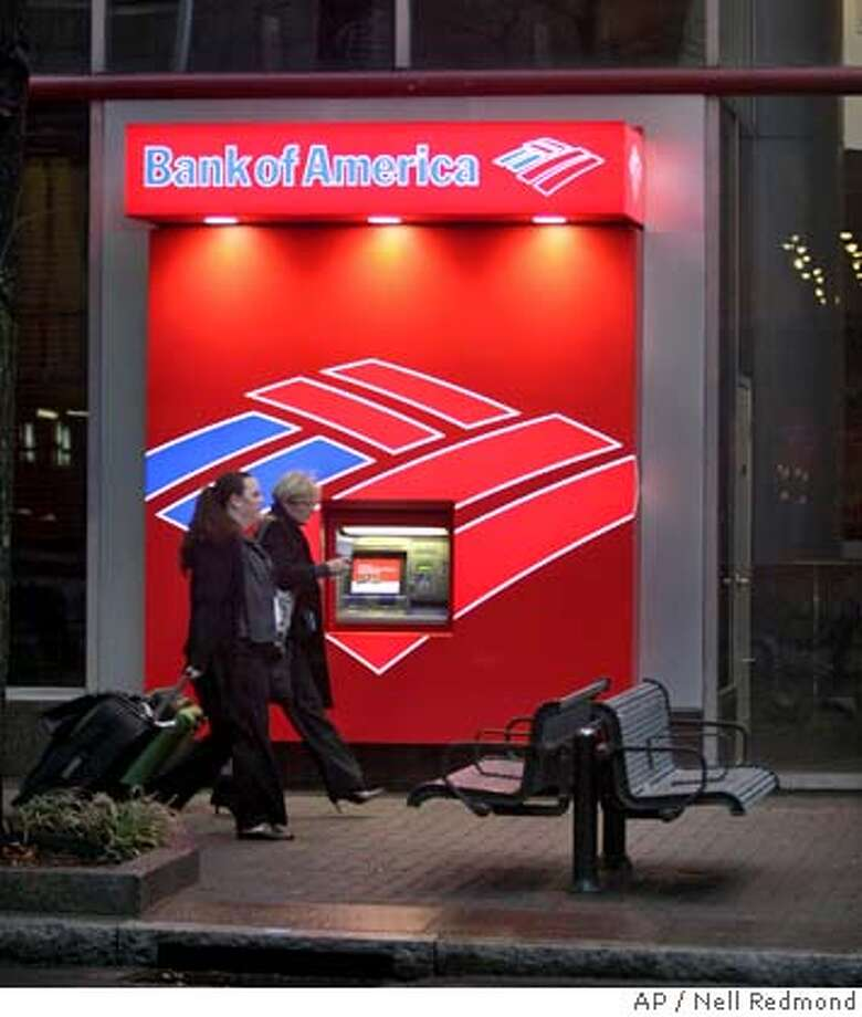 Pedestrians walk past a Bank of America ATM in Charlotte, N.C. near the bank's corporate headquarters on Friday, Jan. 11, 2008. Bank of America Corp. said Friday it has agreed to buy Countrywide Financial for $4 billion in stock, a deal that both rescues the country's biggest mortgage lender and expands the financial services empire of the nation's largest consumer bank. (AP Photo/Nell Redmond) Photo: Nell Redmond