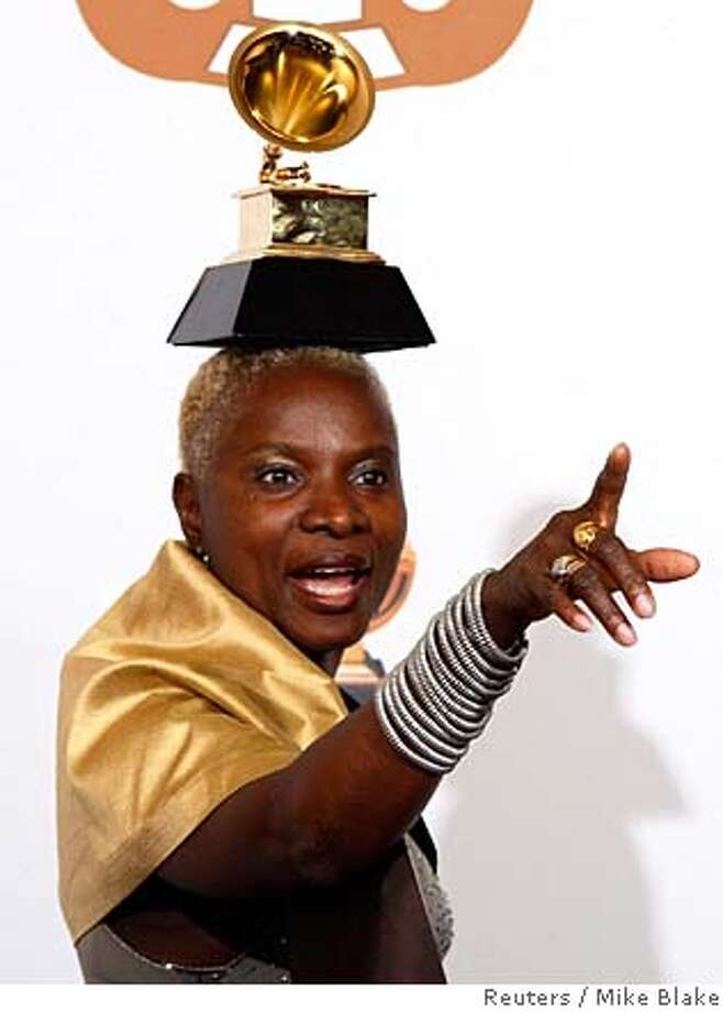 "Angelique Kidjo from Benin poses with the Grammy award for Contemporary World Music for ""Ojin Ojin"" at the 50th Annual Grammy Awards in Los Angeles, California February 10, 2008. REUTERS/Mike Blake (UNITED STATES) Photo: LUCY NICHOLSON"