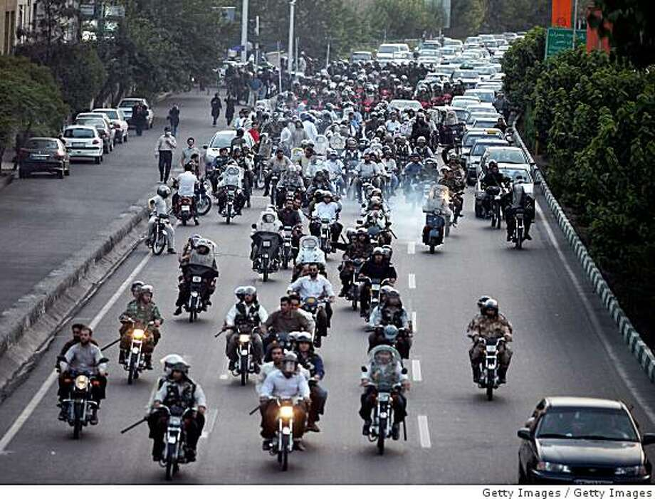 TEHRAN, IRAN - JULY 9:  Iranian Basij ride motorcyles while policing a demonstration on July 9, 2009 in Tehran, Iran. Following recent unrest in the wake of the disputed presidental elections, demonstrators were met by force and tear gas rounds fired by Iranian police and Basij as they defied government warnings to stage a march in commeration of the anniversary of bloody student unrest at Tehran University in 1999.  (Photo by Getty Images) Photo: Getty Images