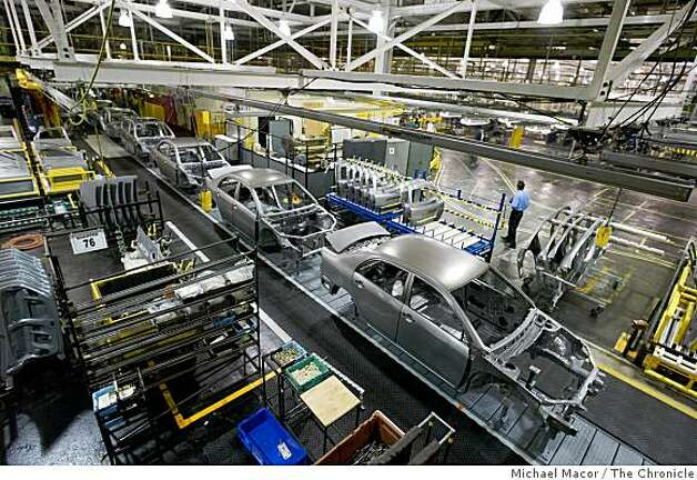 "FILE - Cars are assembled at the NUMMI plant in Fremont, Calif., on January 7, 2002. General Motors has announced it is ending its joint venture with Toyota. GM says it was unable to reach an agreement with Toyota on a new product for the plant and says its stake in Nummi will become part of the ""Old GM"" that will be sold off during its bankruptcy process. Photo: Michael Macor, The Chronicle"