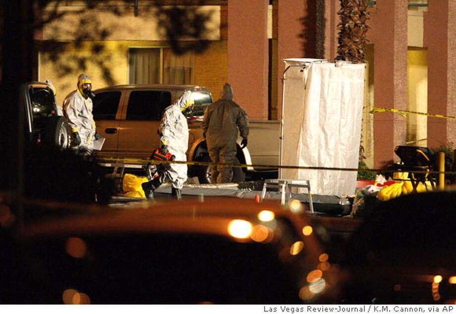 Investigators work a hazardous materials scene at Extended Stay America motel in Las Vegas, on Thursday, Feb. 28, 2008. Police say a man is in critical condition after the deadly toxin ricin was found in his Las Vegas motel room. (AP Photo/Las Vegas Review-Journal, K.M. Cannon) ** MAGS OUT NO SALES INTERNET OUT LAS VEGAS OUT TV OUT ** Photo: K.M. Cannon