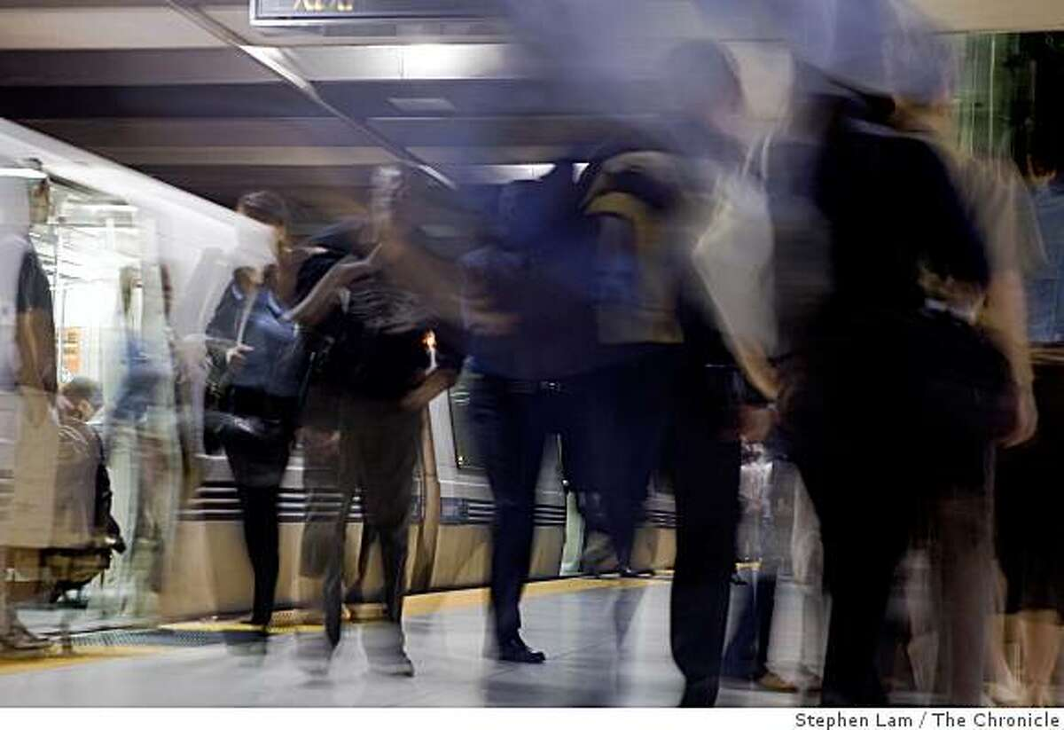 BART commuters exit the trains at Embarcadero station during early morning rush hours in San Francisco Monday morning, June 29, 2009. BART and its two largest unions have agreed to extend labor contract through July 9 to continue ongoing new contract negotiations and forestall possible strike which would cripple the regions traffic and public transportation system. BART currently carries approximately 355,000 riders on a daily basis.