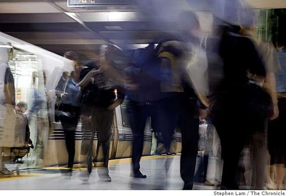 BART commuters exit the trains at Embarcadero station during early morning rush hours in San Francisco Monday morning, June 29, 2009. BART and its two largest unions have agreed to extend labor contract through July 9 to continue ongoing new contract negotiations and forestall possible strike which would cripple the regions traffic and public transportation system. BART currently carries approximately 355,000 riders on a daily basis. Photo: Stephen Lam, The Chronicle
