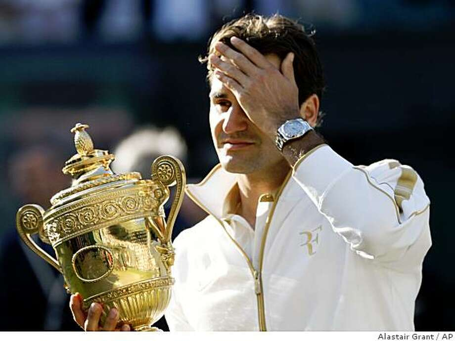 Roger Federer of Switzerland holds the trophy after defeating Andy Roddick to win the men's singles championship on the Centre Court at Wimbledon, Sunday, July 5, 2009. (AP Photo/Alastair Grant) Photo: Alastair Grant, AP