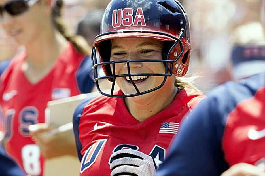 United States' Ashley Hansen smiles after hitting a grand slam against Australia in the third inning of a World Cup of Softball game, in Oklahoma City, Sunday, July 19, 2009. The US beat Australia 8-0 in five innings.(AP Photo/Nati Harnik) Photo: Nati Harnik, AP