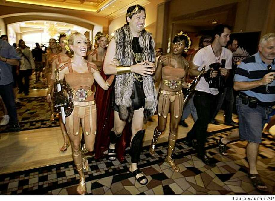 Professional player Phil Hellmuth walks into a throng of fans at the Rio Hotel and Casino in Las Vegas on the third start day of the World Series of Poker on Sunday, July 5, 2009. (AP Photo/Laura Rauch) Photo: Laura Rauch, AP