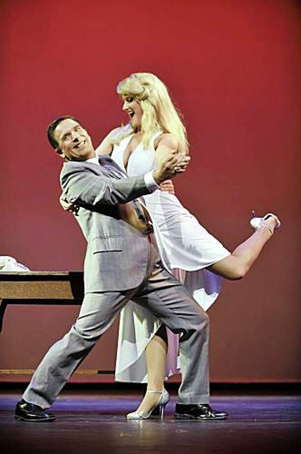 "Tim Reynolds as Leo and Brittany Ogle as Ulla in ""The Producers,"" being presented by Foothill Music Theatre July 24-Aug. 16 at Foothill College, 12345 El Monte Road, Los Altos Hills. Photo: David Allen"