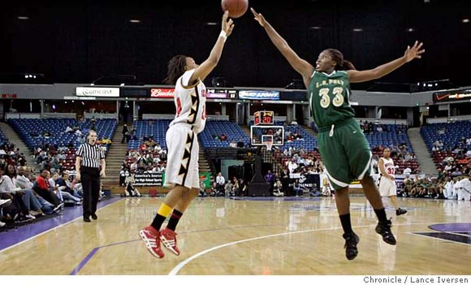 ###Live Caption:###Caption History: .JPG  Berkeley's #24 Jazmine Perkins takes a shot late into the 4th period over Poly's #33 Jasmine Dixon. Northern Cal Division One CIF Champion Berkeley Vs. Southern Cal Division One CIF Champions Poly, won March 24, 2007, in SACRAMENTO, at Arco Arena.  ** (cq, assignment)  Photo By Lance Iversen / The Chronicle  Photo taken on 3/24/07, in SACRAMENTO, CA.###Notes:###Special Instructions:MANDATORY CREDIT PHOTOG AND SAN FRANCISCO CHRONICLE/NO SALES MAGS OUT Photo: By Lance Iversen