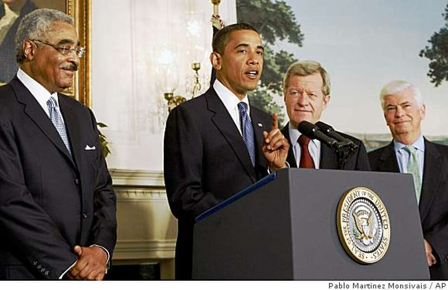 President Barack Obama gestures during his remarks on lower drug cost, Monday, June 22, 2009, in Diplomatic Reception Room of the White House in Washington. From left are, AARP Chief Executive Officer Barry Rand,  the president, Senate Finance Committee Chairman Sen. Max Baucus, D-Mont. and acting Senate Health, Education, Labor and Pensions Committee Chairman Sen. Christopher Dodd, D-Conn.(AP Photo/Pablo Martinez Monsivais) Photo: Pablo Martinez Monsivais, AP