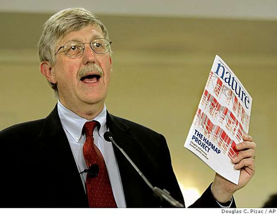 "FILE -- In this Oct. 26, 2005 file photo, Francis Collins holds a copy of ""Nature"" as he speaks during a news conference announcing a new way to search through human DNA for specific genes  in Salt Lake City.  (AP Photo/Douglas C. Pizac, File) Photo: Douglas C. Pizac, AP"