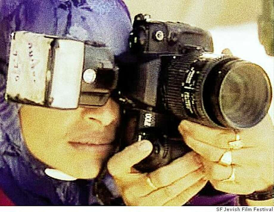 """""""Desert Brides"""" is part of the 2009 San Francisco Jewish Film Festival. Mariam Al-Quader, one of the subjects from Desert Brides, takes a photo at a wedding. Photo: SF Jewish Film Festival"""