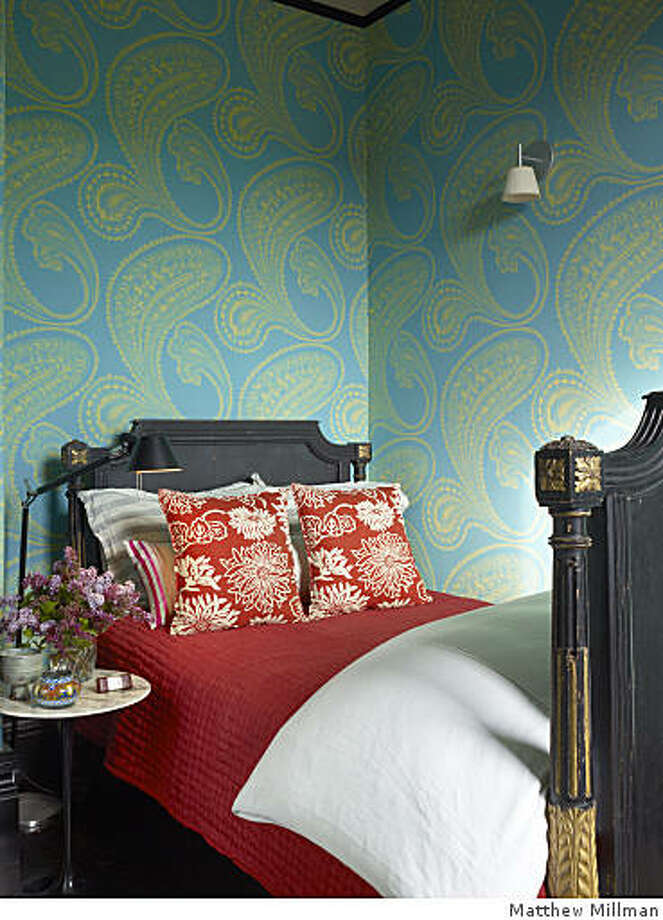 Waterston's modern nod to Victorian decoration: a lively paisley Rajapur wallpaper from Cole & Sons in the bedroom. Photo: Matthew Millman