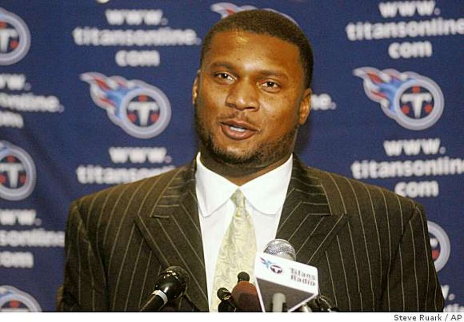 FILE - In this Jan. 2, 2004 file photo, Tennessee Titans quarterback Steve McNair smiles while speaking  in Baltimore about the NFL Most Valuable Player award which he shared with Indianapolis Colts quarterback Peyton Manning.  McNair,  who led the Tennessee Titans within a yard of forcing overtime in the 2000 Superbowl and led the Baltimore Ravens to the playoffs, has been shot and killed on Saturday, July 4, 2009.  Nashville police spokesman Don Aaron confirmed that police were called to a residence and found McNair and a woman shot to death inside. Aaron said authorities don't yet know the circumstances of the shooting.   (AP Photo/Steve Ruark) Photo: Steve Ruark, AP